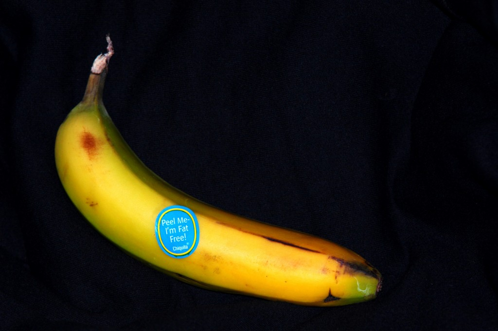 (Banana with sticker reading &quot;Peel Me-- I'm Fat Free!  Chiquita &quot;)